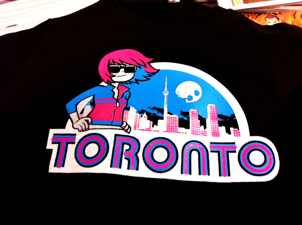 TORONTO T-Shirt, featuring Kim Pine from the Scott Pilgrim series, now in stock. Mens' and Womens' sizes, $20, Beguiling exclusive.